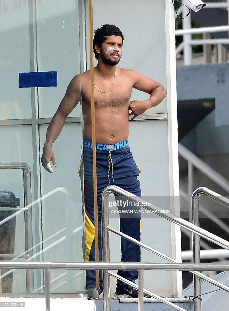 Sri Lankan cricketer Dinesh Chandimal looks on as he stands near the dressing room during a practice session at the R Premadasa International Cricket...