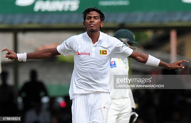 Sri Lankan cricketer Dushmantha Chameera celebrates the wicket of Pakistan cricketer Junaid Khan during the fourth day of the second Test match...