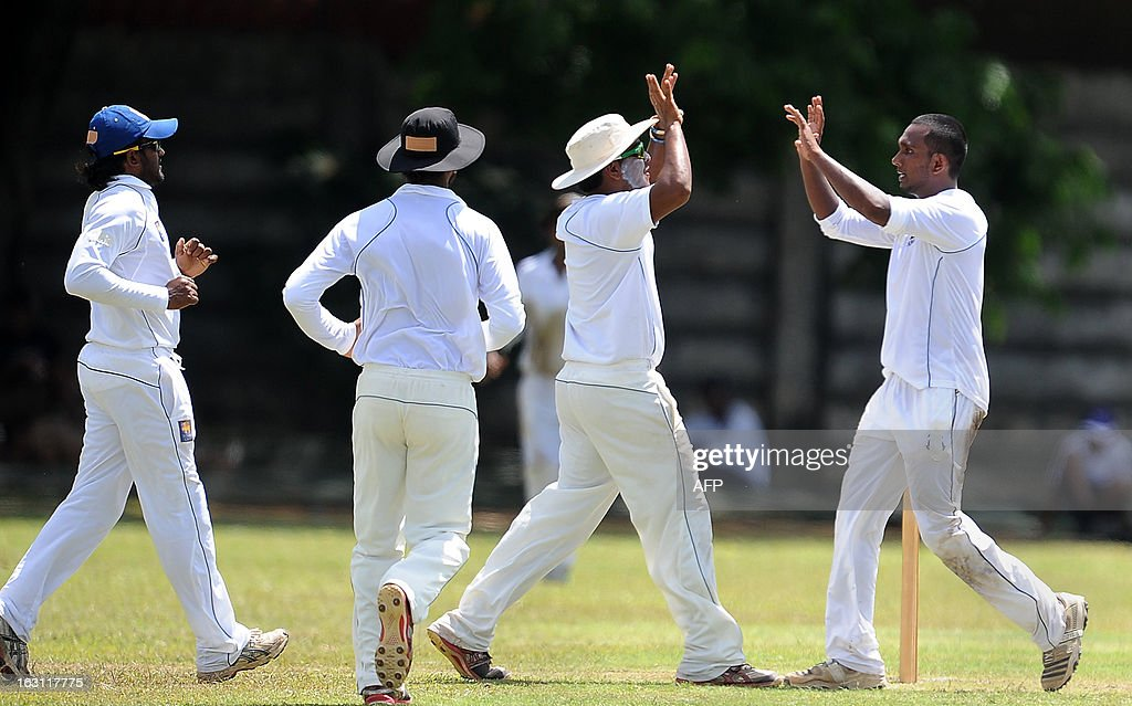 Sri Lankan cricketer Isharan Jayaratne (R) celebrates with teammates the dismissal of Bangladesh cricketer Jahurul Islam during the third day of a three day practice match between the Sri Lanka Development Emerging Team and Bangladesh at the Uyanwatte Stadium in Matara on March 5, 2013.