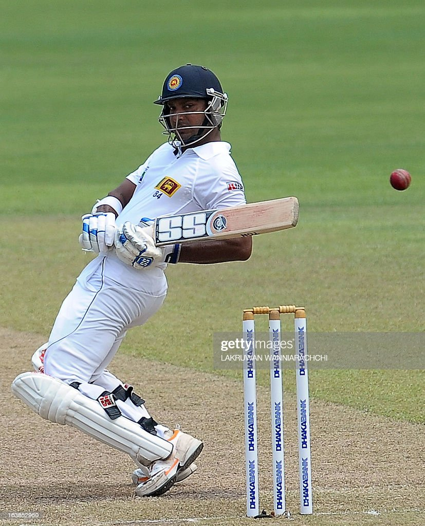 Sri Lankan cricketer Kumar Sangakkara tries to avoid a bouncer during the second day of their second Test match between Sri Lanka and Bangladesh at the R. Premadasa Cricket Stadium in Colombo on March 17, 2013.