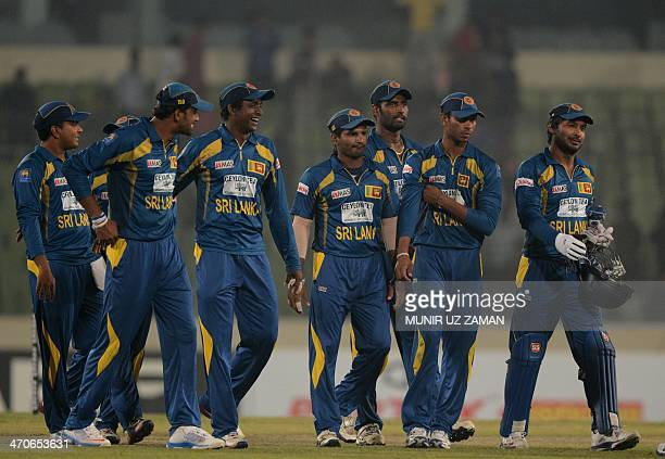 Sri Lankan cricketer Kumar Sangakkara walks off the field with his teammates after winning the second OneDay International cricket match between...