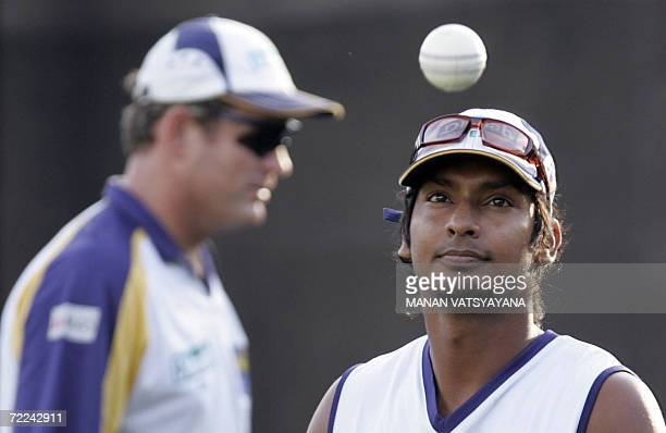 Sri Lankan cricketer Kumar Sangakkara watches the ball during a practice session at the Sardar Patel Stadium in Ahmedabad 23 October 2006 as coach...