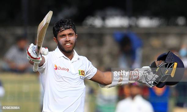 Sri Lankan cricketer Kusal Mendis celebrates after scoring 100 runs during the 3rd Day's play in the 2nd Test match between Sri Lanka and India at...