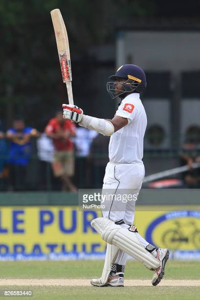Sri Lankan cricketer Kusal Mendis celebrates after scoring 50 runs during the 3rd Day's play in the 2nd Test match between Sri Lanka and India at the...