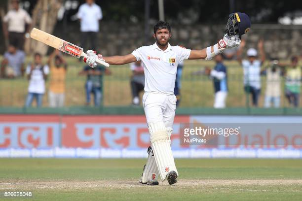 Sri Lankan cricketer Kusal Mendis celebrates after scoring a century the 3rd Day's play in the 2nd Test match between Sri Lanka and India at the SSC...