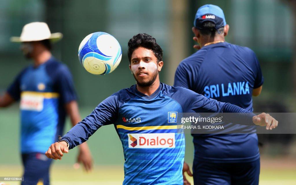 Sri Lankan cricketer Kusal Mendis plays football during a practice session at The P. Sara Oval Cricket Stadium in Colombo on March 14, 2017. Bangladesh play their 100th Test on March 15, against Sri Lanka at The P. Sara Oval Cricket Stadium in Colombo. / AFP PHOTO / Ishara S. KODIKARA