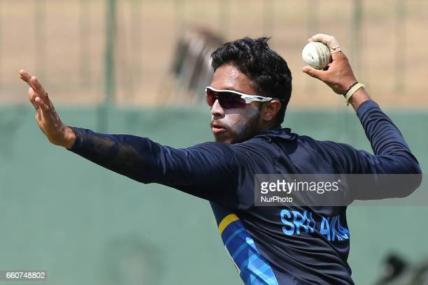 Sri Lankan cricketer Kusal Mendis throws a ball during a practice session at the Sinhalease Sports Club Ground in Colombo on March 30 2017 in...