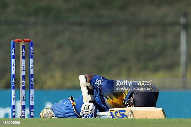 Sri Lankan cricketer Kusal Perera gestures after a yorker ball during the fifth and final one day international cricket match between Sri Lanka and...