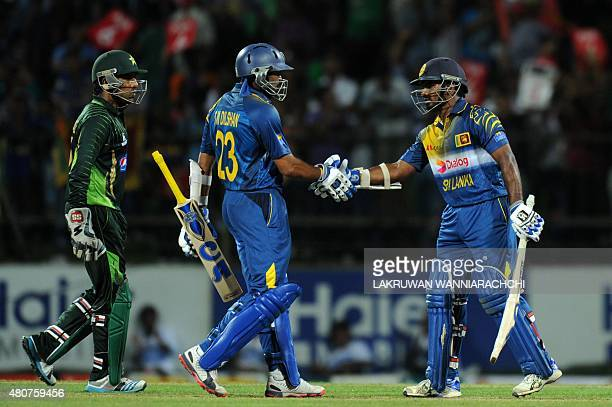 Sri Lankan cricketer Kusal Perera is congratulated by teammate Tillekeratne Dilshan after scoring a halfcentury during the second One Day...