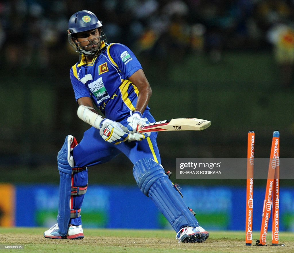 Sri Lankan cricketer Lahiru Thirimanne gets dismissed by Indian cricketer Ravichandran Ashwin during a Twenty20 match between Sri Lanka and India at the Pallekele International Cricket Stadium in Pallekele on August 7, 2012. AFP PHOTO/ Ishara S.KODIKARA