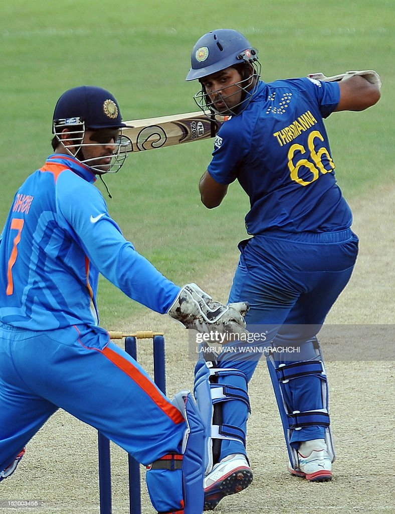 Sri Lankan cricketer Lahiru Thirimanne (R) is watched by Indian wicketkeeper Mahendra Singh Dhoni (L) as he plays a shot during an ICC Twenty20 Cricket World Cup warm-up match between Sri Lanka and India at The P. Sara Oval Ground in Colombo on September 15, 2012. The two-yearly tournament in cricket's shortest format will be played from September 18 to October 7, with Hambantota holding three matches, Pallekele nine and capital Colombo fifteen.