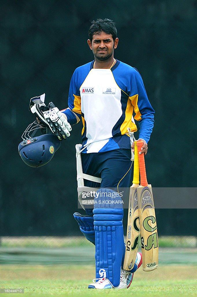 Sri Lankan cricketer Lahiru Thirimanne waits to bat during a practice session at the Suriyawewa Mahinda Rajapakse International Cricket Stadium in the southern district of Hambantota on September 21, 2012. AFP PHOTO / Ishara S
