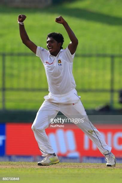 Sri Lankan cricketer Lakshan Sandakan celebrates the dismissal of Indian cricket captain Virat Kohli during the 1st Day's play in the 3rd Test match...
