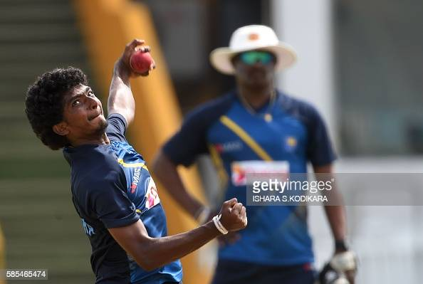 Sri Lankan cricketer Lakshan Sandakan delivers a ball during a practice session at The Galle International Cricket Stadium in Galle on August 3 2016...