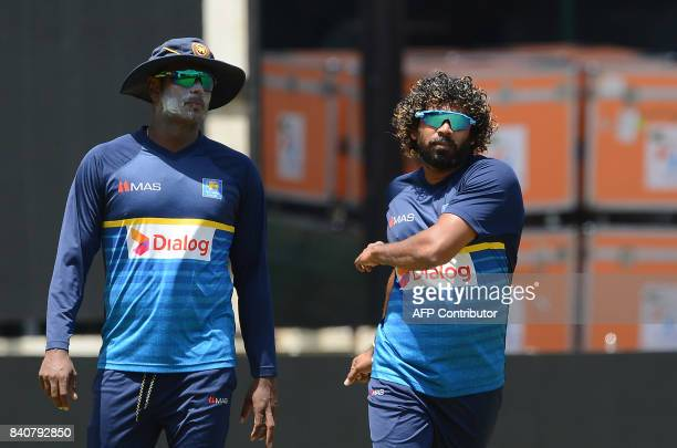 Sri Lankan cricketer Lasith Malinga and Angelo Mathews warm up during a practice session at The RPeremadasa Stadium in Colombo on August 30 2017 The...