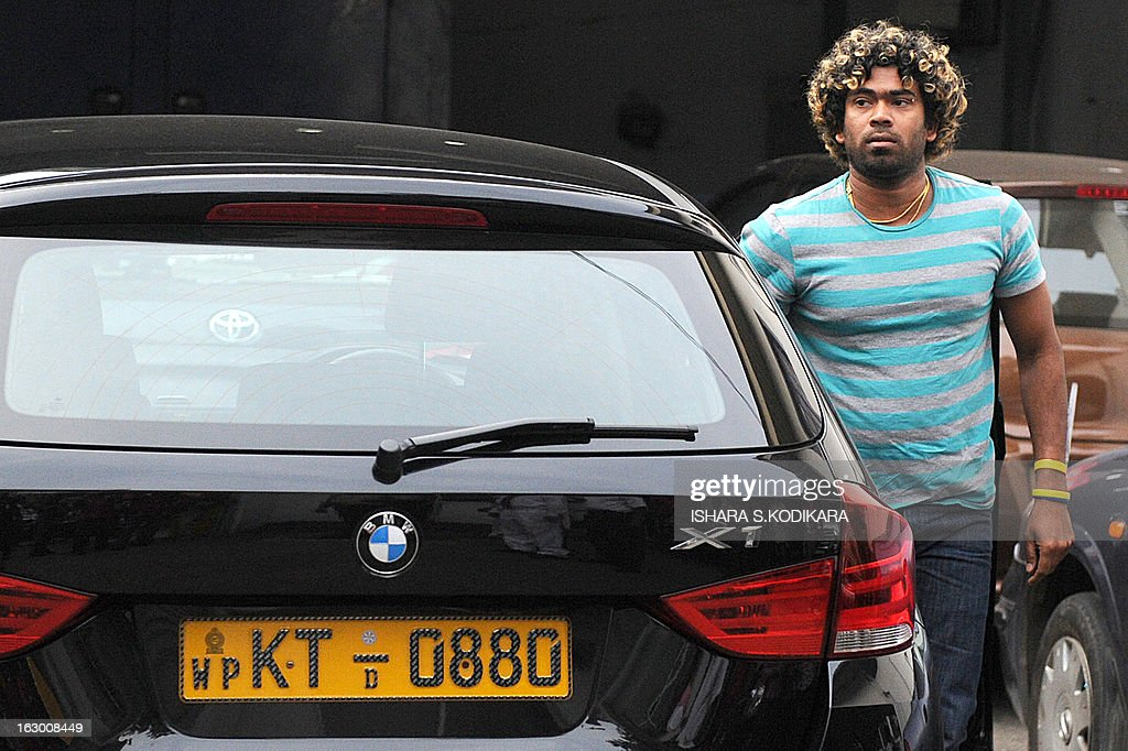 Sri Lankan cricketer Lasith Malinga arrives at the Sri Lanka Cricket office to hold talks with selectors in Colombo on March 3, 2013. Sri Lanka's national cricketers dropped a controversial pay demand today, clearing the way for them to play against Bangladesh in an upcoming series, a top official said. Chief Selector Sanath Jayasuriya said he held crisis talks with the rebellious players who agreed to the same terms and conditions offered by Sri Lanka Cricket (SLC) and would be available for selection for the first Test starting March 8. AFP PHOTO / Ishara S