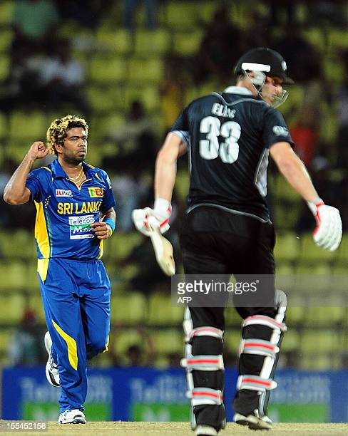 Sri Lankan cricketer Lasith Malinga celebrates after he dismissed New Zealand criketer Andrew Ellis during the second One Day International match...
