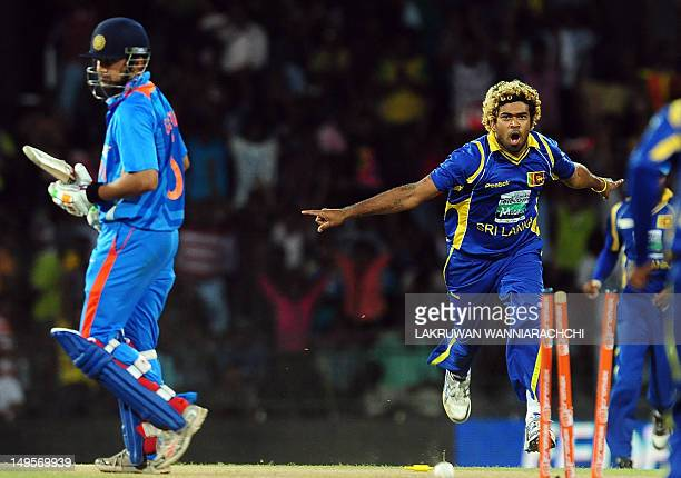 Sri Lankan cricketer Lasith Malinga celebrates after he dismissed Indian cricketer Gautam Gambhir during the fourth one day international match...