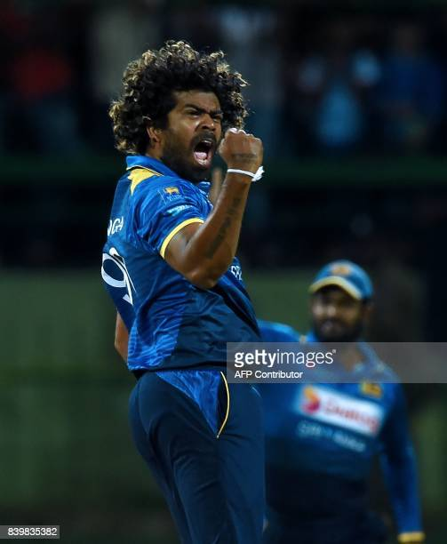 Sri Lankan cricketer Lasith Malinga celebrates after he dismissed Indian batsman Shikar Dhawan during the third one day international cricket match...