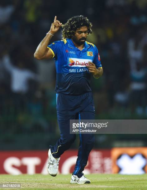 Sri Lankan cricketer Lasith Malinga celebrates after he dismissed Indian cricketer Ajinkya Rahane during the final one day international cricket...