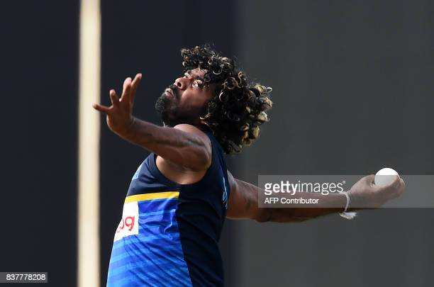 Sri Lankan cricketer Lasith Malinga delivers a ball during a practice session at the Pallekele International Cricket Stadium in Pallekele on August...