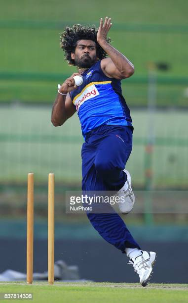 Sri Lankan cricketer Lasith Malinga delivers a ball during a practice session ahead of the 2nd ODI cricket match between Sri Lanka and India at...