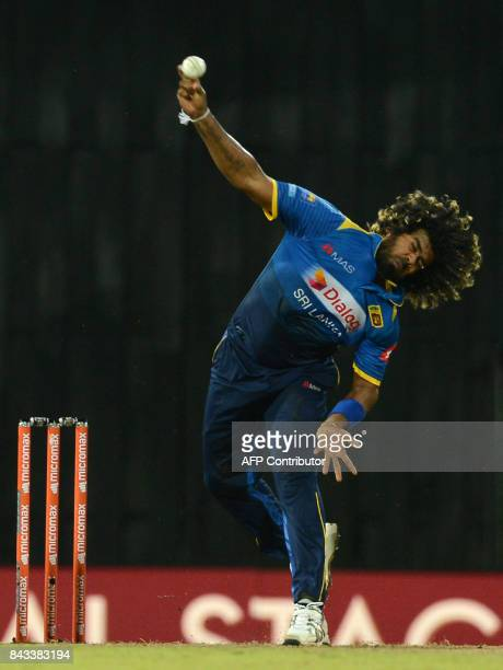 Sri Lankan cricketer Lasith Malinga delivers the ball during the Twenty20 international cricket match between Sri Lanka and India at R Premadasa...