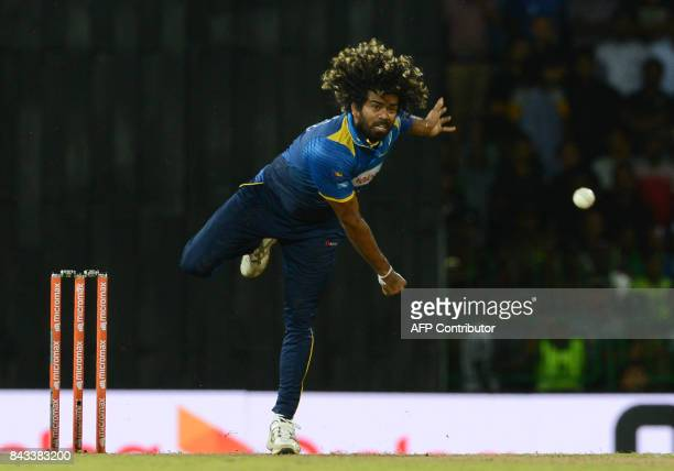 TOPSHOT Sri Lankan cricketer Lasith Malinga delivers the ball during the Twenty20 international cricket match between Sri Lanka and India at R...
