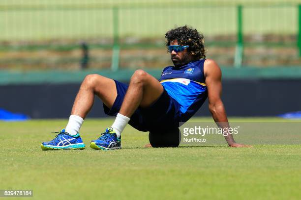Sri Lankan cricketer Lasith Malinga is seen during a practice session ahead of the 3rd ODI cricket match against India at Pallekele International...