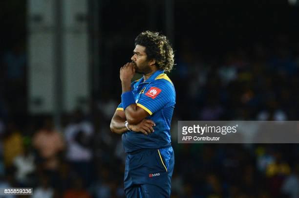 Sri Lankan cricketer Lasith Malinga looks on during the first One Day International cricket match between Sri Lanka and India at the Rangiri Dambulla...