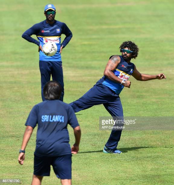 Sri Lankan cricketer Lasith Malinga plays football with teammates during a practice session at the Pallekele International Cricket Stadium in...