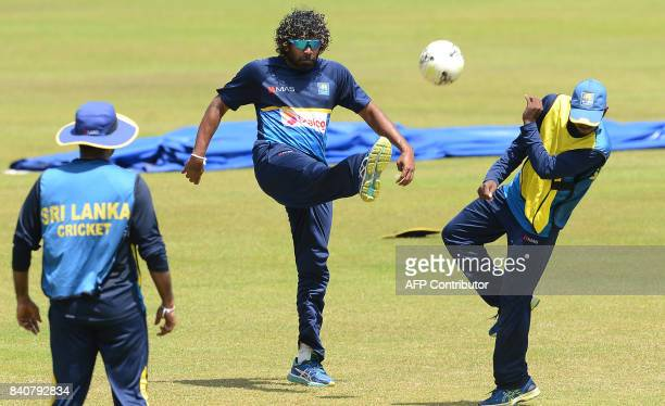 TOPSHOT Sri Lankan cricketer Lasith Malinga plays football with teammates during a practice session at The RPeremadasa Stadium in Colombo on August...