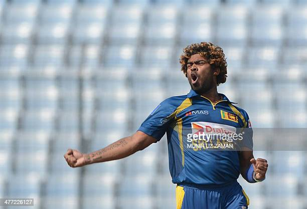 Sri Lankan cricketer Lasith Malinga reacts after the dismissal of Pakistan cricketer Mohammad Hafeez during the final match of the Asia Cup oneday...