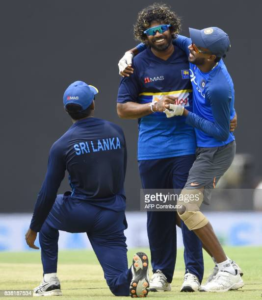 Sri Lankan cricketer Lasith Malinga shares a light moment with Indian cricketer Hardik Pandya before the second one day international cricket match...