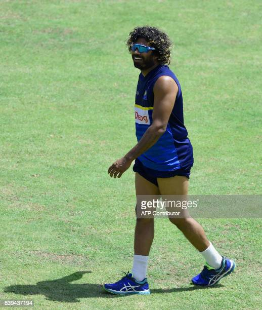 Sri Lankan cricketer Lasith Malinga takes part in a practice session at the Pallekele International Cricket Stadium in Pallekele on August 26 2017...