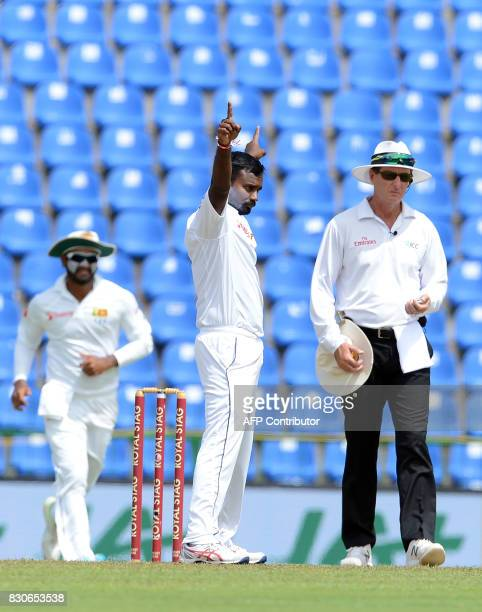 Sri Lankan cricketer Malinda Pushpakumara celebrates after he dismissed Indian cricketer Shikhar Dhawan during the first day of the third and final...