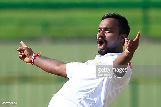 Sri Lankan cricketer Malinda Pushpakumara celebrates the dismissal of Indian batsman Ajinkya Rahane during the 1st Day's play in the 3rd Test match...