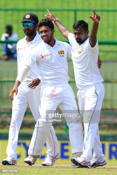Sri Lankan cricketer Malinda Pushpakumara celebrates with his team mates after taking a wicket during the 1st Day's play in the 3rd Test match...