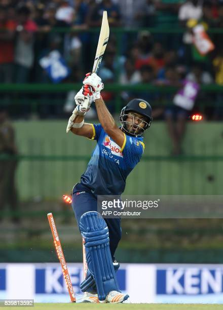 Sri Lankan cricketer Milinda Siriwardana is bowled out by Indian cricketer Jasprit Bumrah during the third one day international cricket match...
