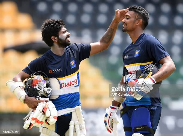 Sri Lankan cricketer Niroshan Dickwella and teammate Danushka Gunathilaka takes part in a practice session at the R Premadasa Cricket Stadium in...