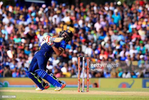 Sri Lankan cricketer Niroshan Dickwella avoids a bouncer ball during the 1st One Day International cricket match bewtween Sri Lanka and India at...