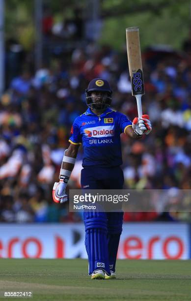 Sri Lankan cricketer Niroshan Dickwella celebrates after scoring 50 runs during the 1st One Day International cricket match bewtween Sri Lanka and...