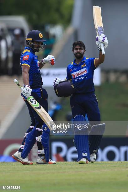 Sri Lankan cricketer Niroshan Dickwella celebrates his centurt with his partner Danushka Gunathilaka during the 4th One Day International cricket...