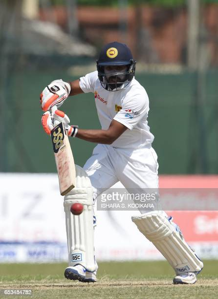 Sri Lankan cricketer Niroshan Dickwella plays a shot during the first day of the second and final Test match between Sri Lanka and Bangladesh at the...