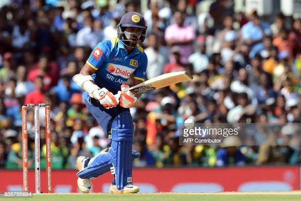 Sri Lankan cricketer Niroshan Dickwella plays a shot during the first One Day International cricket match between Sri Lanka and India at the Rangiri...