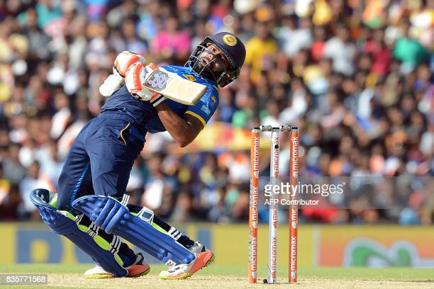 TOPSHOT Sri Lankan cricketer Niroshan Dickwella tries to avoid a bouncer of Indian cricketer Hardik Pandya during the first One Day International...