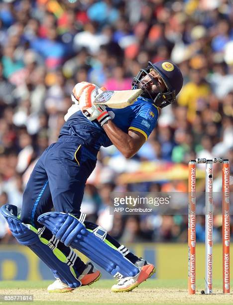 Sri Lankan cricketer Niroshan Dickwella tries to avoid a bouncer of Indian cricketer Hardik Pandya during the first One Day International cricket...