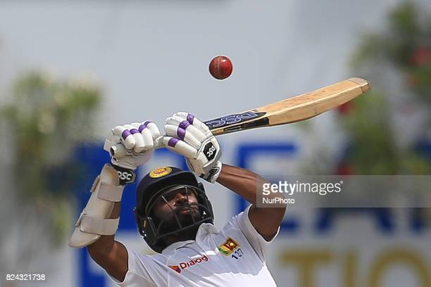 Sri Lankan cricketer Niroshan Dickwella tries to play a shot during the 4th Day's play in the 1st Test match between Sri Lanka and India at the Galle...