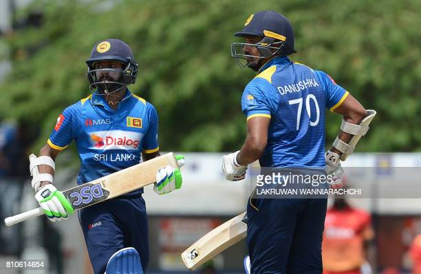 Sri Lankan cricketer Niroshan Dikwella and teammate Danushka Gunathilaka run between the wickets during the fourth oneday international cricket match...