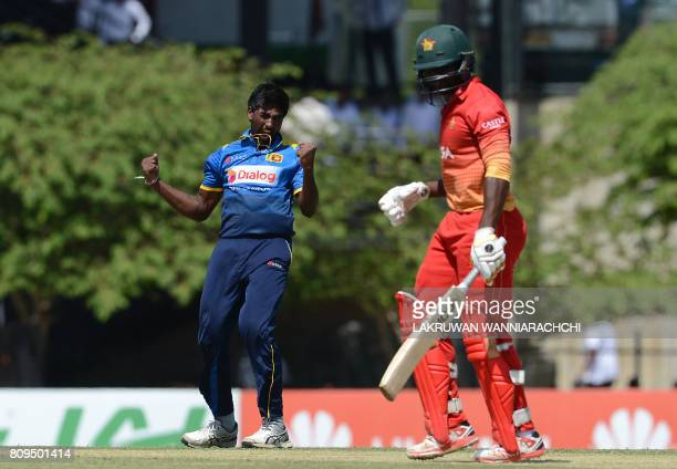 Sri Lankan cricketer Nuwan Pradeep celebrates after he dismissed Zimbabwe cricketer Solomon Mire during the third oneday international cricket match...